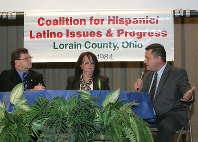17OCT12 / Chuck Humel    Terry Boose, left, and Mathew Lark , right, at the CHIP Debate at St. Joe's Community Center.  The two are squaring off for the Ohio House of Representatives.  The moderator, center, is Mary Santiago.