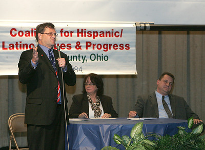 17OCT12 / Chuck Humel    Terry Boose, left, and Mathew Lark , right, at the CHIP Debate at St. Joe's Community Center.  The moderator, center, is Mary Santiago.