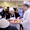 J.S.CARRAS/THE RECORD  Volunteers Theresa Cavaleri, of Albany and Ginny Dollar, of Colonie serve meals as Capital City Rescue Mission celebrates Christmas Wednesday, December 25, 2013 Christmas day in Albany, N.Y..