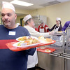 J.S.CARRAS/THE RECORD Volunteer Mike Cavaleri, serves meals as Capital City Rescue Mission celebrates Christmas Wednesday, December 25, 2013 Christmas day in Albany, N.Y..