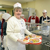 J.S.CARRAS/THE RECORD  Volunteer Ginny Dollar, of Colonie serve meals as Capital City Rescue Mission celebrates Christmas Wednesday, December 25, 2013 Christmas day in Albany, N.Y..