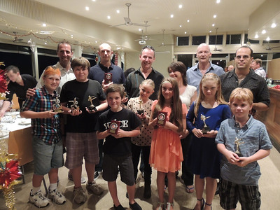 Award winners (from left front children) Jack Bowen, Joe Harris, Harry Bowen, Eryn Newton-Brown, Lucy Harris, Ayeisha Schultz, Vincent Truluck. (Adults from rear left) Andrew Bowen, Nigel Heald, Russell Newton-Brown, Loren Anerson, Shihan Martin Day, Marco Nadal at the Combat Karate Christmas Party 2013