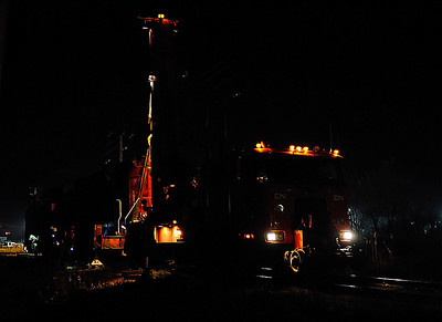 Canadian National crane lifting SD70M-2 #8951 at St Jean, CN Rouses Point Subdivision.