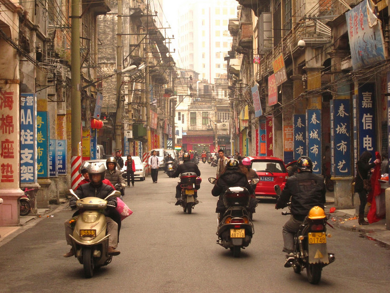 Motorbikes rule the roads in Jiangmen's historic district.