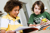 CO9<br /> <br /> Choice 9 of 15<br /> <br /> Two Boys Doing Homework --- Image by © Emely/cultura/Corbis