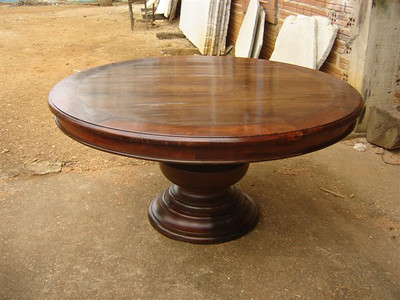 Round bulbous pedestal table. antique exotic hardwood canella top with king wood boarder. 1