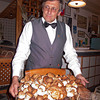 Venanzio's wonderful (part owner) owner, Roberto with a plate of mushrooms.