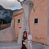 "Adrienne and John at the feet of the ""Cavatore"", a wonderful church and statue dedicated to the men who work the ""Caves"" of Carrara marble."