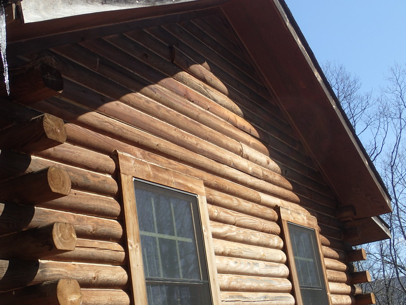 The cabin has a insulated attic, so the top 15 rows are faux log facia.  The facia needs to be resecured to the structure
