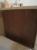 """Apple Valley.  Walnut veneer.  2nd bath.  Replace or repair side panel of vanity.  20 3/4"""" wide x 22 5/8"""" tall"""
