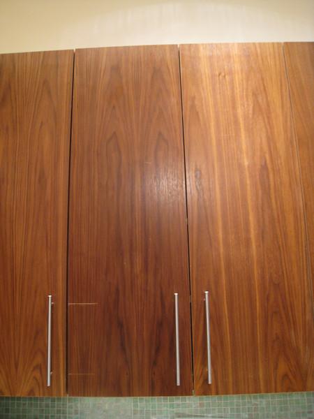 """Apple Valley.  Walnut veneer.  Kitchen. Replace door.  41 7/8"""" tall x 13 7/8"""" wide"""