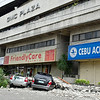 Two SUV's were damaged after debris fall from the nearby building of GMC Plaza in downtown Cebu City.(Jojo Abcede/Sun.Star)