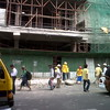 Workers clear debris that fell from this construction site along Colon Street, Cebu City. A strong earthquake shook the Visayas Tuesday morning. (Daryl D. Anunciado photo/Sunnex)