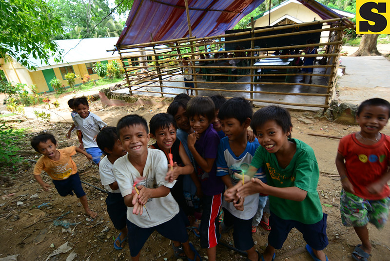 At play in makeshift schools of Bohol