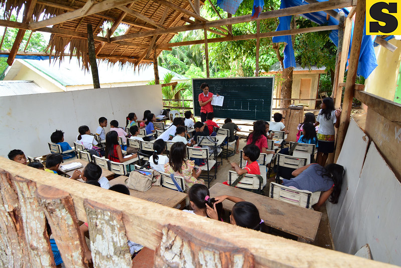 At play in makeshift schools of Bohol