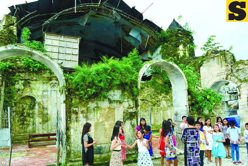 Loboc Children's Choir rehearses outside Bohol church ruins