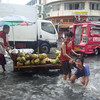 Coconut vendor in the middle of flooded street in Cebu City