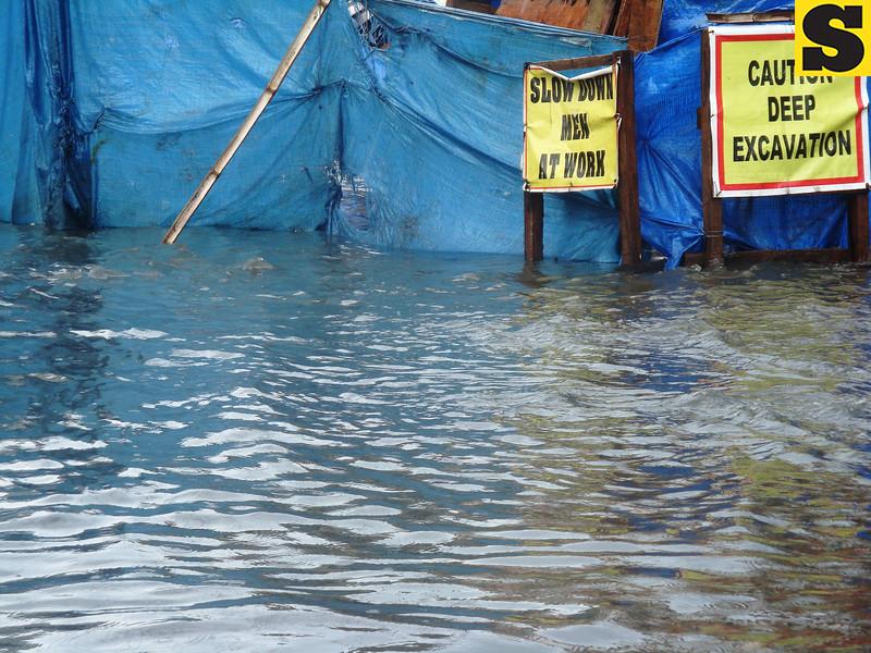 Road construction along flooded street in Cebu City