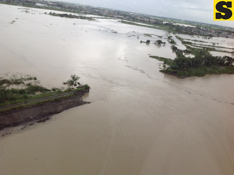 BREACHED DIKE. This aerial photo shows the 80-meter breached portion of the San Fernando-Sto.Tomas-Minalin tail dike that caused massive flooding in the said towns. (Chris Navarro)