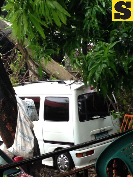 CEBU CITY. A concrete post fell off this vehicle parked inside a compound in Barangay Guadalupe on Friday. (Jean Mondoñedo-Ynot/Sunnex)