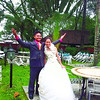YOLANDA WEDDING. With some typhoon debris in the background, PO2 Ronald Manlangit and Myrna Bacarisas celebrate their wedding. (Rebelander S. Basilan of Sun.Star Cebu)