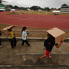 Athletes vacate the Lamberto Macias Sports complex after Deped suspend the CVIRAA games due to Typhoon Pablo. (Alex Badayos)