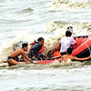 DAVAO. A rubber boat almost capsizes with the strong impact of monsoon waves brought by Typhoon Pablo as rescuers are about to return to the shore after a rescue operation in Barangay 76-A, Bucana. (Seth delos Santos)