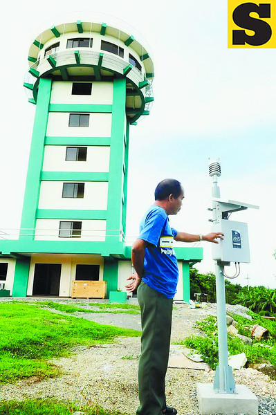 MORE HIGH-TECH THAN A WINDOW. An Automated Weather Station at the Mactan station of Pagasa will be augmented with other devices as the bureau tries to make its forecasts more timely and more accurate.(Arni Aclao)