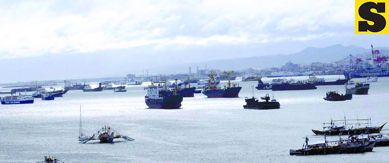 Small and big seacrafts alike hiding at the Mactan Channel as typhoon Pablo was approaching Cebu. (Allan Cuizon)