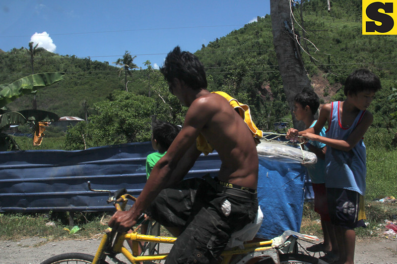 Typhoon Yolanda survivors onboard a trisikad
