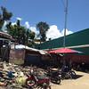 Makeshift house beside ships in Anibong, Tacloban
