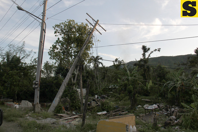 Electric posts toppled by Typhoon Yolanda
