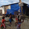 Children playing in a village named after Typhoon Yolanda