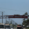 Welcome marker damaged by Typhoon Yolanda