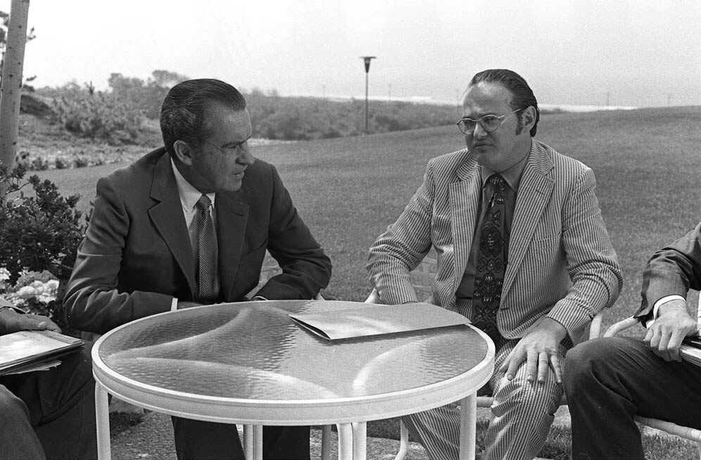 . President Richard M. Nixon, left, and Dr. Jerome Jaffe, special consultant to the President for Narcotics and Dangerous Drugs, sit at a table on lawn behind Nixon\'s Western White House office July 17,1971. The two met to discuss Dr. Jaffe\'s recent trip to several foreign nations to consider drug problems. (AP Photo/stf)
