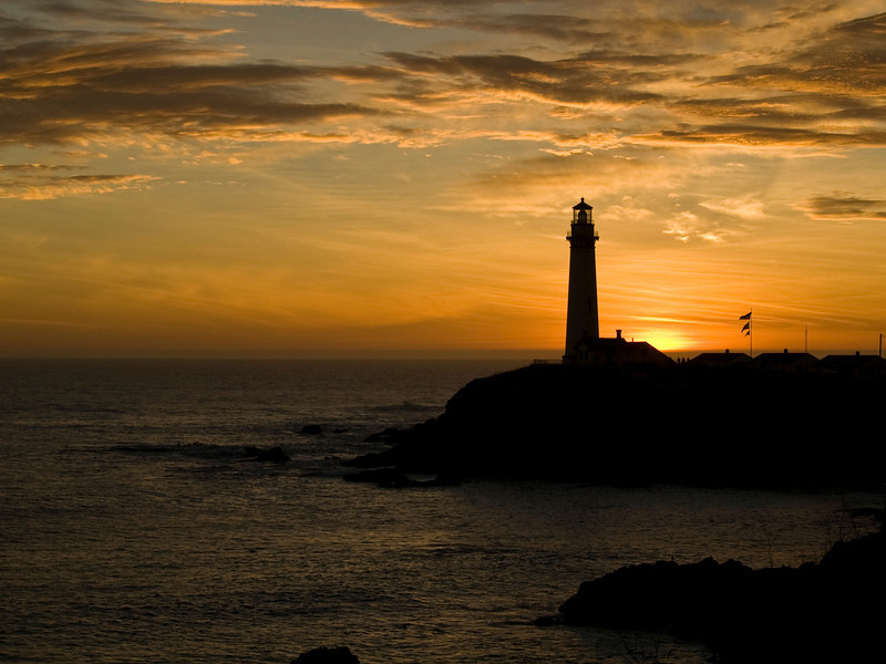 Sunset on the Pacific coast with the Pigeon Point Lighthouse beaming it's light which only happens once a year.
