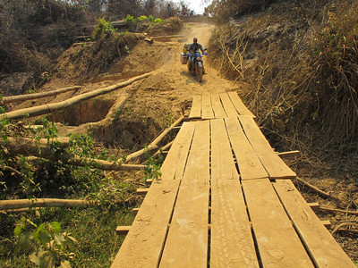 It's not long before we come to the next one - another sandy track down to a make-shift bridge over a dried up river bed.