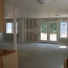 Standing in the kitchen of our house looking at the dining/living/den space.