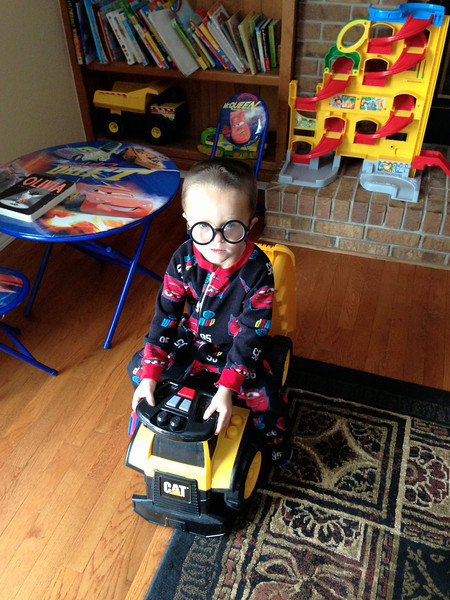 Nathan cracks me up, he found the where's Waldo glasses and is wearing them this morning.