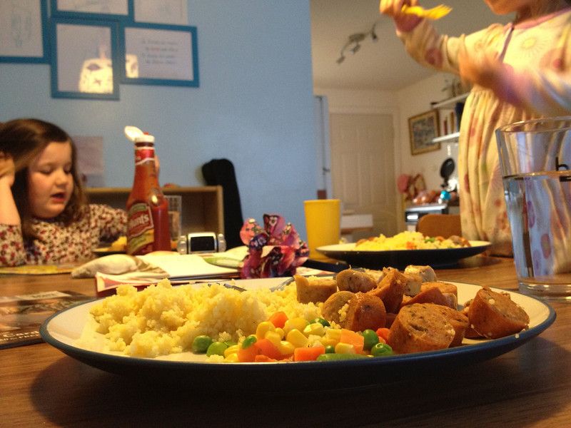 Traditional Monday night dinner: Papa, Catherine and Esme; chicken sausage, couscous, and veggies.