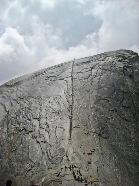 Long line of hikers on Half Dome