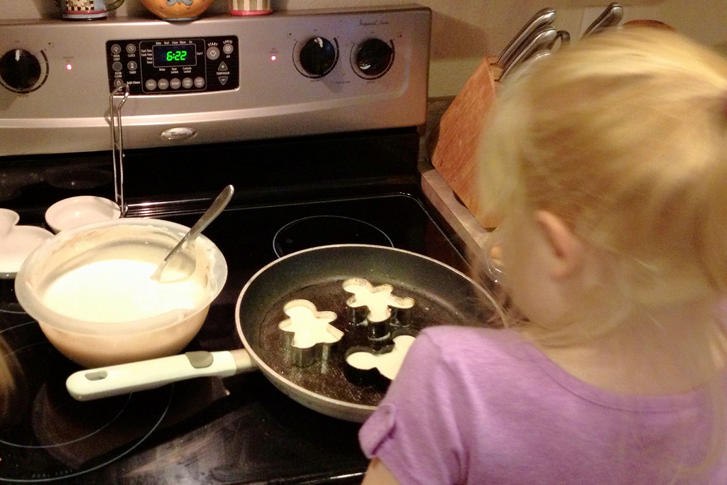 Breakfast for dinner: Gluten-free, egg-free pancakes shaped like Mickey ears, plus a boy and girl for good measure.