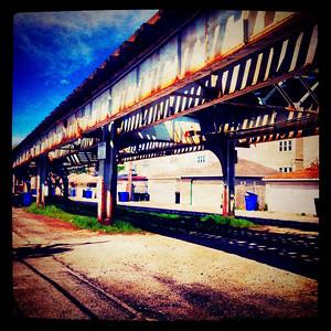 Chicago El tracks in the alley.