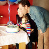 Jennie & Gordon helping Kieran blow out the candles on the cake to celebrate his 1st Birthday.