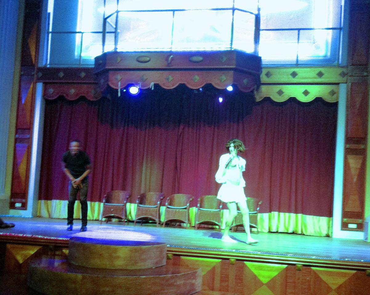 Dan Olson onstage performing in Jamaica