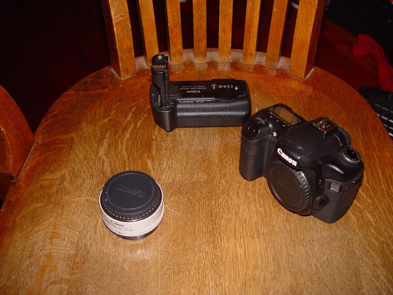 Left Canon Lens extender 1.4x, 6th on list<br /> Center, battery grip, 8th on list<br /> Right, Canon 40D body, 7th on list