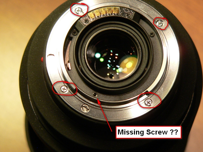Back end of Sigma 50-500mm DG.  I had a lot of play in the mount when the camera body was mounted - maybe a half mm.  Checked and all the circled screws were loose.  But it looks like a screw is missing.  What is going on?  A refurb?<br /> <br /> The camera store swapped this for a new unit.<br /> .