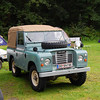 Cool restored Land Rover. He pulled a pop-up trailer