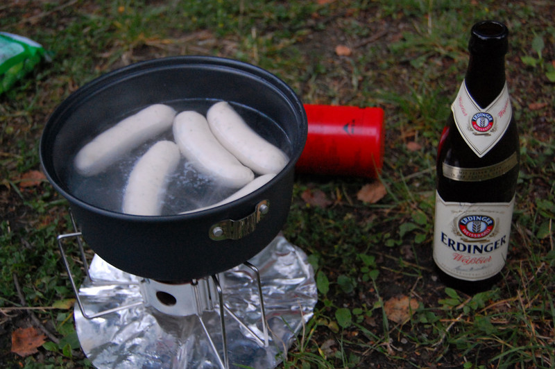Sausage and beer on my backpack stove.