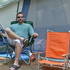 David Hollis, of Berlin, relaxes near his tent at the Minuteman Campground in Littleton on Thursday afternoon. SENTINEL & ENTERPRISE / Ashley Green